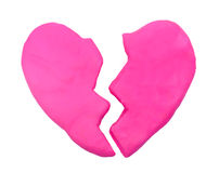 Pink broken heart shape plasticine clay Stock Images