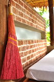 Pink broom on brick wall Stock Photo