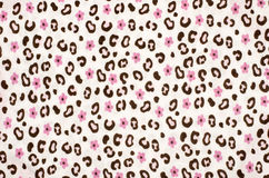 Pink and brown leopard pattern with flowers. Stock Photos