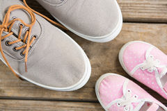 Pink and brown shoes on wooden floor Royalty Free Stock Photography