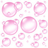 Pink Bubbles Design Elements. As isolated spheres and delicate transparent dainty soap sud bubble composition with suds in many circular sizes in the air Royalty Free Stock Image