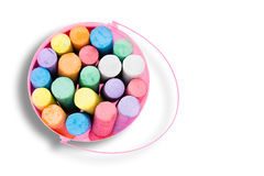 Pink bucket of colorful chalk crayons Royalty Free Stock Images