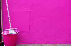 Pink bucket and a mop Stock Image
