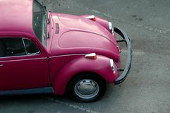 Pink Bug. A top view of an older pink VW bug royalty free stock photography