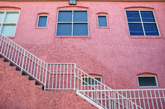 Pink Building with White Staircase Stock Image