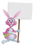 Pink bunny rabbit with carrot and sign Royalty Free Stock Photography