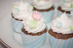 Pink butter-cream cupcake with flowe. Cup cakes with cream and various colorful Stock Photography