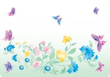 Pink butterflies above blue flowers Royalty Free Stock Photo