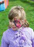 Pink Butterfly. With glitter is on little girl face Royalty Free Stock Photos