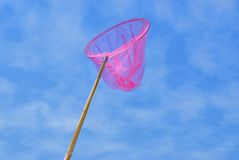 Pink butterfly net. Picture of a Pink butterfly net over blue sky Stock Photo