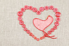 Pink buttons in form of the heart Royalty Free Stock Images