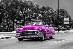 Pink cabriolet classic car on the Malecon in Cuba Havana.  Stock Photography
