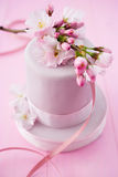 Pink cake with cherryblossoms Stock Photo