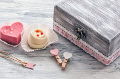 Pink cake heart with an old box. Royalty Free Stock Photo