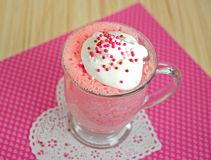 Pink cake in mug on lace heart Stock Photo