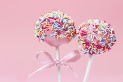 Pink cake pops decorated with colorful sprinkles. Stock Photos