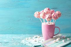 Pink cake pops. In a teacup stock images