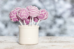 Pink cake pops on winter background Stock Photos