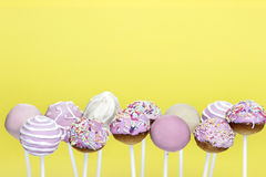 Pink cake pops on yellow background Stock Image