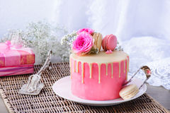 Pink cake and present Stock Image