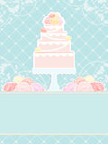 Pink cake and roses on blue background Royalty Free Stock Photo