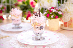 Pink cake souffle in a glass. At sunset Stock Image