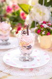 Pink cake souffle in a glass. At sunset Royalty Free Stock Photo