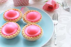 Pink cakes on blue plate Stock Photo