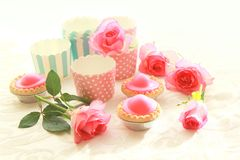 Pink cakes  and pink roses Royalty Free Stock Image