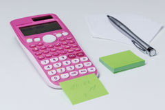 Pink calcalator. Pink scientific calculator for school and office Stock Photos