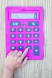 Pink calculator Stock Images