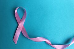 Pink ribbon symbol of the fight against the disease royalty free stock photos