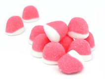 Pink candies. Pink sugary candies over white background Stock Photo