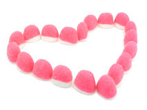 Pink candies heart. Heart made of pink sugary candies over white background Royalty Free Stock Photography