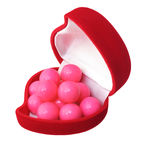 Pink candies in heart sharp box Royalty Free Stock Photos