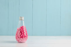 Pink candies in transparent glass bottle background Stock Photo