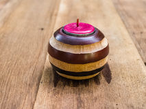Pink candle in patterned holder Royalty Free Stock Image