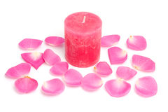 Pink candle and rose leaves Royalty Free Stock Photos