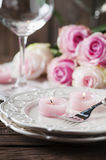 Pink candle and roses on the table Royalty Free Stock Image