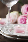 Pink candle and roses on the table Stock Images