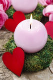 Pink candle and wooden red heart Stock Photography