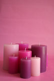 Pink candles. Against pink background Stock Photography