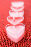 Pink candles in form of heart Royalty Free Stock Photography