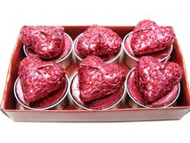 Pink candles set heart shape. Set of heart candles as present in red box Royalty Free Stock Image
