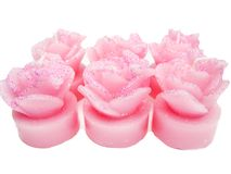 Pink candles set rose flowers shape Stock Photos