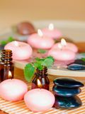 Pink candles, stones, and essential oil. Royalty Free Stock Photography