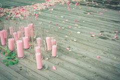 Pink candles on the wooden floor in the glass Royalty Free Stock Images