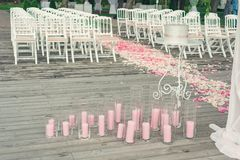 Pink candles on a wooden floor Stock Photography