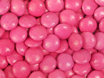 Pink Candy. Pink coated chocolate sweets background Royalty Free Stock Photo