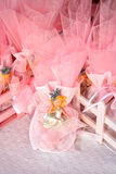Pink candy favors. Christening candy favors on a basket Royalty Free Stock Images